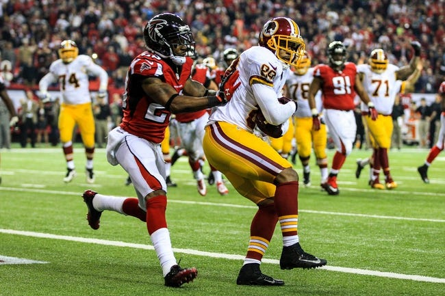 Dec 15, 2013; Atlanta, GA, USA; Washington Redskins wide receiver Santana Moss (89) catches a touchdown pass over Atlanta Falcons cornerback Robert Alford (23) in the second half at the Georgia Dome. The Falcons won 27-26. Mandatory Credit: Daniel Shirey-USA TODAY Sports