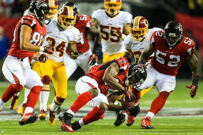 Dec 15, 2013; Atlanta, GA, USA; Atlanta Falcons fullback Jason Snelling (44) recovers an onside kick in the second half against the Washington Redskins at the Georgia Dome. The Falcons won 27-26. Mandatory Credit: Daniel Shirey-USA TODAY Sports