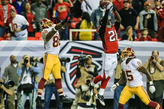 Dec 15, 2013; Atlanta, GA, USA; Atlanta Falcons cornerback Desmond Trufant (21) breaks up a two-point conversion pass intended for Washington Redskins wide receiver Pierre Garcon (88) in the second half at the Georgia Dome. The Falcons won 27-26. Mandatory Credit: Daniel Shirey-USA TODAY Sports