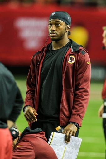 Dec 15, 2013; Atlanta, GA, USA; Washington Redskins quarterback Robert Griffin III (10) on the sidelines in the second half against the Atlanta Falcons at the Georgia Dome. The Falcons won 27-26. Mandatory Credit: Daniel Shirey-USA TODAY Sports