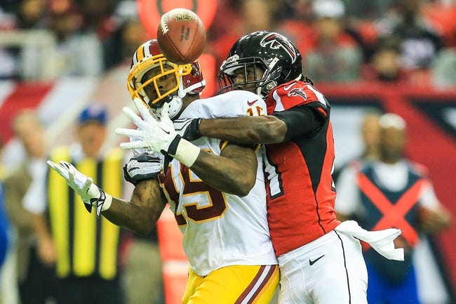 Dec 15, 2013; Atlanta, GA, USA; Atlanta Falcons cornerback Desmond Trufant (21) breaks up a pass intended for Washington Redskins wide receiver Josh Morgan (15) in the second half at the Georgia Dome. The Falcons won 27-26. Mandatory Credit: Daniel Shirey-USA TODAY Sports