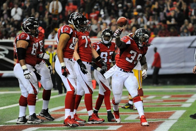 Dec 15, 2013; Atlanta, GA, USA; Atlanta Falcons running back Steven Jackson (39) reacts after scoring a touchdown against the Washington Redskins during the second half at the Georgia Dome. The Falcons defeated the Redskins 27-26. Mandatory Credit: Dale Zanine-USA TODAY Sports