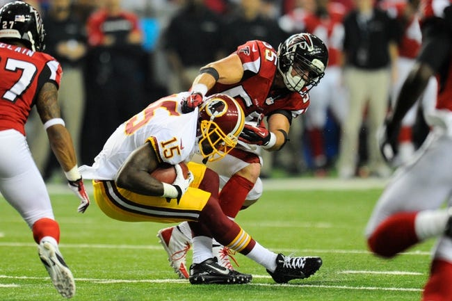 Dec 15, 2013; Atlanta, GA, USA; Atlanta Falcons linebacker Paul Worrilow (55) tackles Washington Redskins wide receiver Josh Morgan (15) during the second half at the Georgia Dome. The Falcons defeated the Redskins 27-26. Mandatory Credit: Dale Zanine-USA TODAY Sports