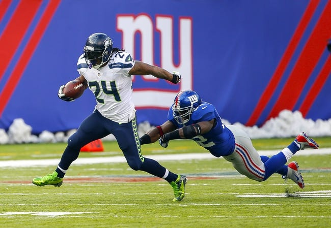 Dec 15, 2013; East Rutherford, NJ, USA;  Seattle Seahawks running back Marshawn Lynch (24) avoids a tackle of New York Giants middle linebacker Jon Beason (52) at MetLife Stadium. Mandatory Credit: Jim O'Connor-USA TODAY Sports