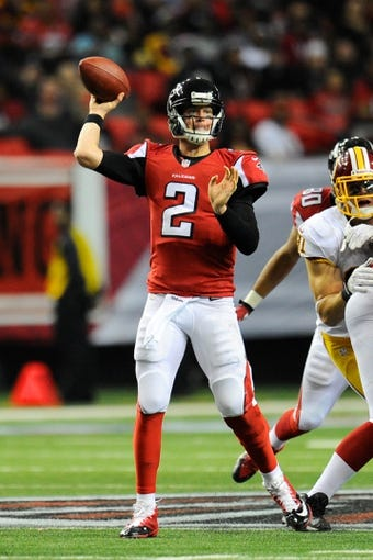Dec 15, 2013; Atlanta, GA, USA; Atlanta Falcons quarterback Matt Ryan (2) passes the ball against the Washington Redskins during the second half at the Georgia Dome. The Falcons defeated the Redskins 27-26. Mandatory Credit: Dale Zanine-USA TODAY Sports