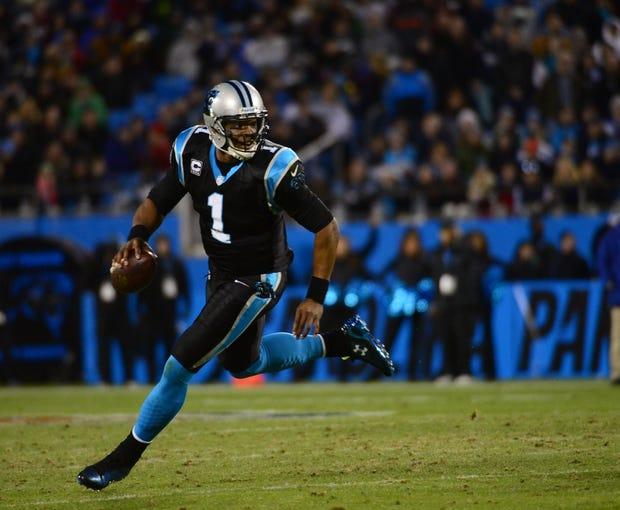 Dec 15, 2013; Charlotte, NC, USA; Carolina Panthers quarterback Cam Newton (1) looks to pass in the third quarter at Bank of America Stadium. Mandatory Credit: Bob Donnan-USA TODAY Sports