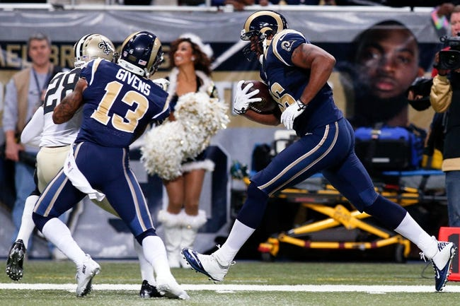 Dec 15, 2013; St. Louis, MO, USA;  St. Louis Rams tight end Cory Harkey (46) carries the ball for a touchdown during the first quarter against the New Orleans Saints at the Edward Jones Dome. Mandatory Credit: Scott Kane-USA TODAY Sports