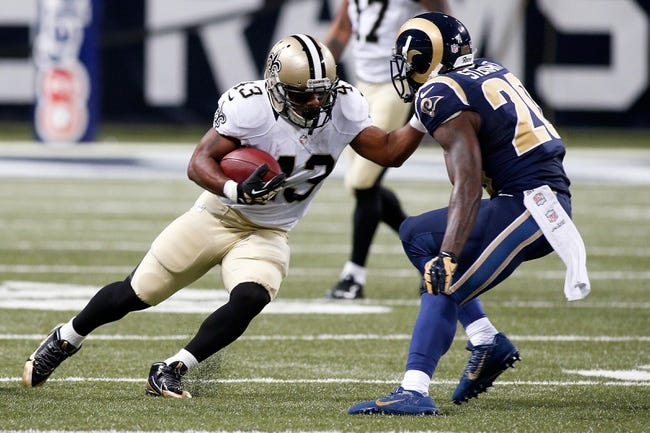 Dec 15, 2013; St. Louis, MO, USA;  New Orleans Saints running back Darren Sproles (43) carries the ball as St. Louis Rams strong safety Darian Stewart (20) defends during the first half at the Edward Jones Dome. Mandatory Credit: Scott Kane-USA TODAY Sports