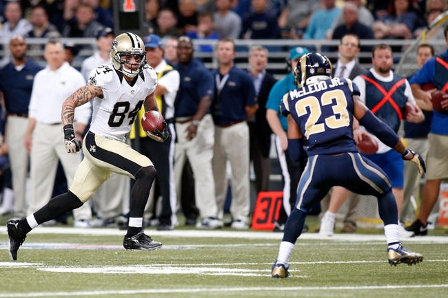 Dec 15, 2013; St. Louis, MO, USA; New Orleans Saints wide receiver Kenny Stills (84) carries the ball as St. Louis Rams free safety Rodney McLeod (23) defends during the first half  at the Edward Jones Dome. Mandatory Credit: Scott Kane-USA TODAY Sports