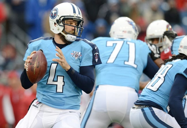 Dec 15, 2013; Nashville, TN, USA; Tennessee Titans quarterback Ryan Fitzpatrick (4) drops back to throw against the Arizona Cardinals during the first half at LP Field. Mandatory Credit: Don McPeak-USA TODAY Sports