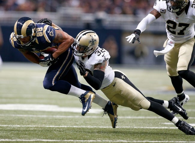 Dec 15, 2013; St. Louis, MO, USA; St. Louis Rams tight end Lance Kendricks (88) is tackled by New Orleans Saints strong safety Kenny Vaccaro (32) during a game at the Edward Jones Dome. Mandatory Credit: Scott Kane-USA TODAY Sports