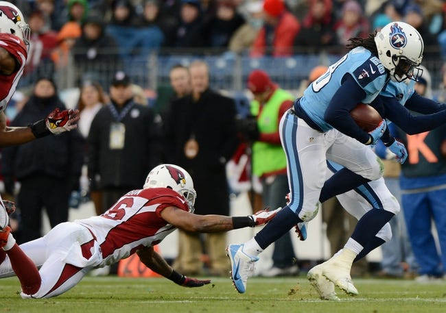 Dec 15, 2013; Nashville, TN, USA; Tennessee Titans running back Chris Johnson (28) runs with the ball against Arizona Cardinals safety Rashad Johnson (26) during the first half at LP Field. Mandatory Credit: Don McPeak-USA TODAY Sports