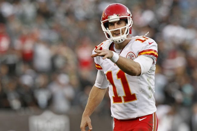 Dec 15, 2013; Oakland, CA, USA; Kansas City Chiefs quarterback Alex Smith (11) reacts after the Chiefs rushed for a touchdown against the Oakland Raiders in the fourth quarter at O.co Coliseum. The Chiefs defeated the Raiders 56-31. Mandatory Credit: Cary Edmondson-USA TODAY Sports