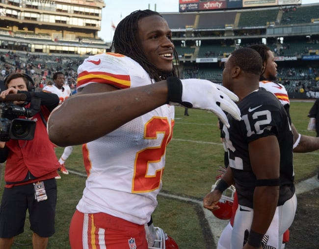 Dec 15, 2013; Oakland, CA, USA; Kansas City Chiefs running back Jamaal Charles (25) reacts at the end of the game against the Oakland Raiders at O.co Coliseum. The Chiefs defeated the Raiders 56-31. Mandatory Credit: Kirby Lee-USA TODAY Sports
