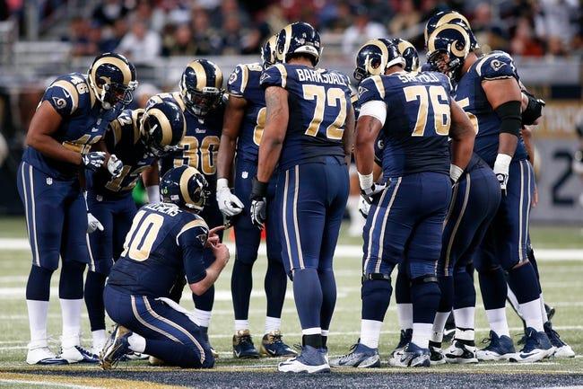 Dec 15, 2013; St. Louis, MO, USA; The St. Louis Rams offense huddles around quarterback Kellen Clemens (10) against the New Orleans Saints at the Edward Jones Dome. Mandatory Credit: Scott Kane-USA TODAY Sports