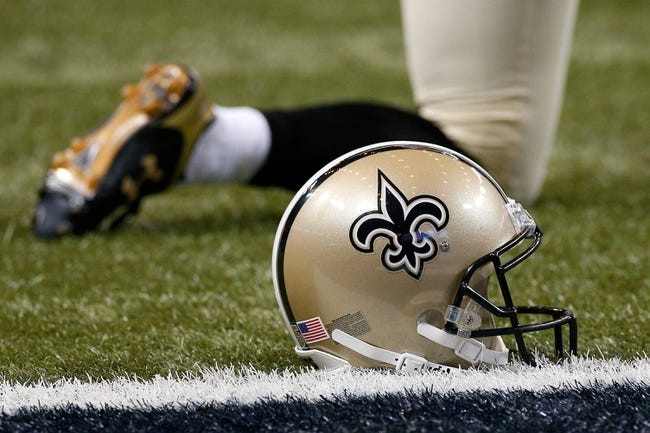 Dec 15, 2013; St. Louis, MO, USA; A New Orleans Saints helmet rest on the field against the St. Louis Rams at the Edward Jones Dome. Mandatory Credit: Scott Kane-USA TODAY Sports