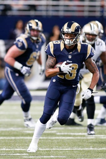 Dec 15, 2013; St. Louis, MO, USA;  St. Louis Rams wide receiver Chris Givens (13) carries the ball against the New Orleans Saints at the Edward Jones Dome. Mandatory Credit: Scott Kane-USA TODAY Sports