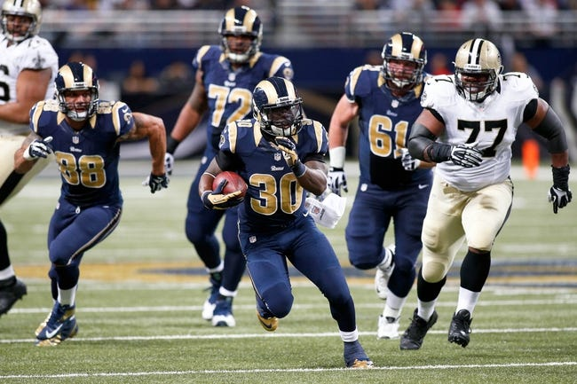 Dec 15, 2013; St. Louis, MO, USA; St. Louis Rams running back Zac Stacy (30) carries the ball for a touchdown during the first half against the New Orleans Saints at the Edward Jones Dome. Mandatory Credit: Scott Kane-USA TODAY Sports