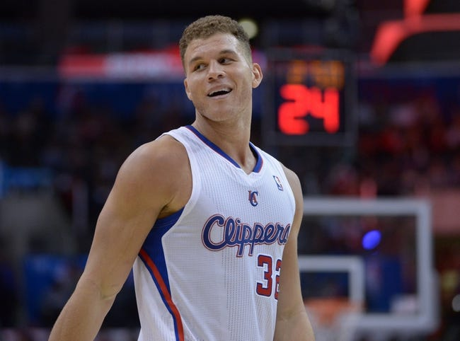Dec 16, 2013; Los Angeles, CA, USA; Los Angeles Clippers forward Blake Griffin (32) reacts in the fourth quarter against the San Antonio Spurs at Staples Center. The Clippers defeated the Spurs 115-92. Mandatory Credit: Kirby Lee-USA TODAY Sports