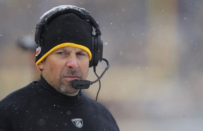 Dec 8, 2013; Pittsburgh, PA, USA; Pittsburgh Steelers offensive coordinator Todd Haley looks on from the sidelines against the Miami Dolphins during the second quarter at Heinz Field. The Dolphins won 34-28. Mandatory Credit: Charles LeClaire-USA TODAY Sports