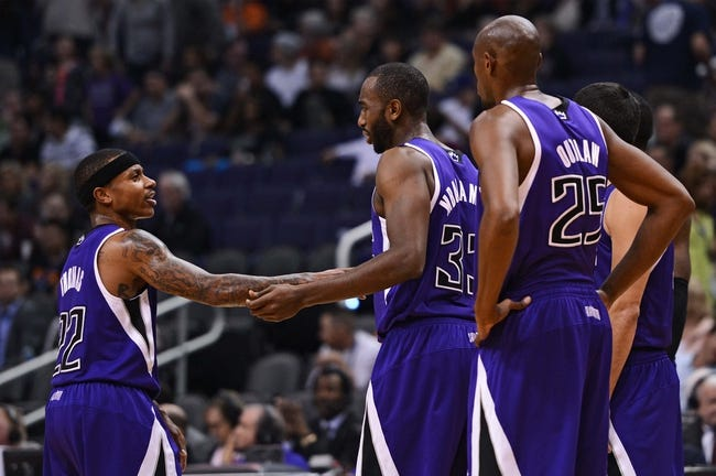 Nov 20, 2013; Phoenix, AZ, USA; Sacramento Kings guard Isaiah Thomas (22) talks with forward Luc Mbah a Moute (33) and forward Travis Outlaw (25) in the game against the Phoenix Suns at US Airways Center. The Kings defeated the Suns 113-106. Mandatory Credit: Jennifer Stewart-USA TODAY Sports