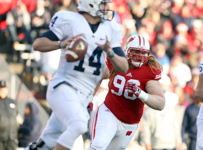 Nov 30, 2013; Madison, WI, USA; Wisconsin Badgers guard Beau Allen (96) defends against Penn State Nittany Lions quarterback Christian Hackenberg (14) at Camp Randall Stadium. Penn State defeated Wisconsin 31-24. Mandatory Credit: Mary Langenfeld-USA TODAY Sports