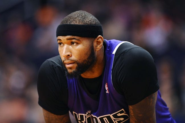 Nov 20, 2013; Phoenix, AZ, USA; Sacramento Kings center DeMarcus Cousins (15) watches from the free throw line in the first half of the game against the Phoenix Suns at US Airways Center. The Kings defeated the Suns 113-106. Mandatory Credit: Jennifer Stewart-USA TODAY Sports