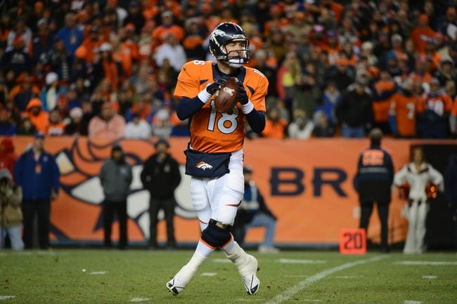 November 17, 2013; Denver, CO, USA; Denver Broncos quarterback Peyton Manning (18) looks for a receiver during the third quarter against the Kansas City Chiefs at Sports Authority Field at Mile High. The Broncos defeated the Chiefs 27-17. Mandatory Credit: Kyle Terada-USA TODAY Sports