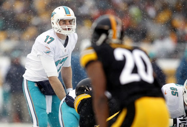 Dec 8, 2013; Pittsburgh, PA, USA; Miami Dolphins quarterback Ryan Tannehill (17) looks over the Pittsburgh Steelers defense at the line of scrimmage during the second quarter at Heinz Field. The Dolphins won 34-28. Mandatory Credit: Charles LeClaire-USA TODAY Sports