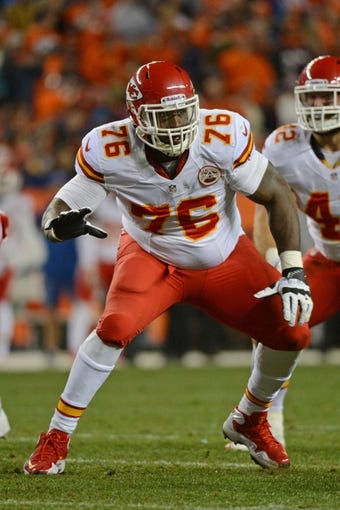 November 17, 2013; Denver, CO, USA; Kansas City Chiefs tackle Branden Albert (76) blocks during the second quarter against the Denver Broncos at Sports Authority Field at Mile High. The Broncos defeated the Chiefs 27-17. Mandatory Credit: Kyle Terada-USA TODAY Sports