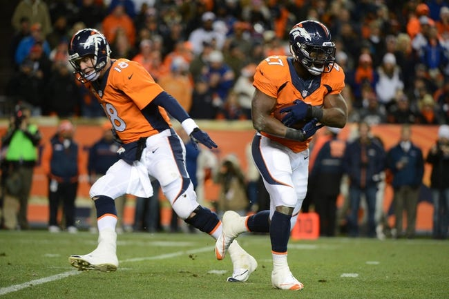 November 17, 2013; Denver, CO, USA; Denver Broncos running back Knowshon Moreno (27) runs with the football after a hand off from quarterback Peyton Manning (18) during the first quarter against the Kansas City Chiefs at Sports Authority Field at Mile High. The Broncos defeated the Chiefs 27-17. Mandatory Credit: Kyle Terada-USA TODAY Sports