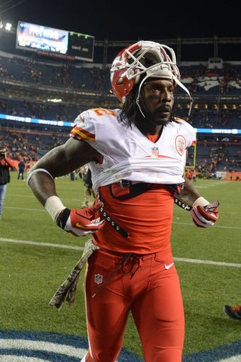 November 17, 2013; Denver, CO, USA; Kansas City Chiefs wide receiver Dwayne Bowe (82) leaves the field after the game against the Denver Broncos at Sports Authority Field at Mile High. The Broncos defeated the Chiefs 27-17. Mandatory Credit: Kyle Terada-USA TODAY Sports