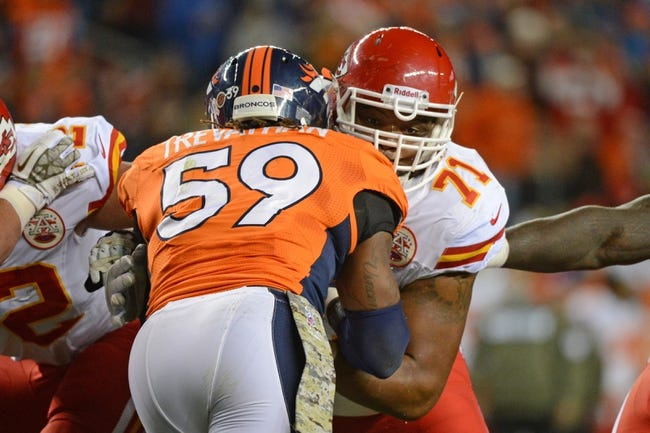 November 17, 2013; Denver, CO, USA; Kansas City Chiefs guard Jeff Allen (71) blocks Denver Broncos outside linebacker Danny Trevathan (59) during the second quarter at Sports Authority Field at Mile High. The Broncos defeated the Chiefs 27-17. Mandatory Credit: Kyle Terada-USA TODAY Sports