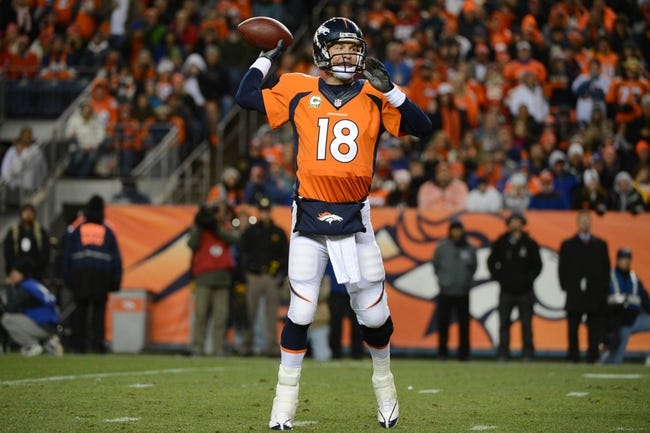 November 17, 2013; Denver, CO, USA; Denver Broncos quarterback Peyton Manning (18) passes the football during the third quarter against the Kansas City Chiefs at Sports Authority Field at Mile High. The Broncos defeated the Chiefs 27-17. Mandatory Credit: Kyle Terada-USA TODAY Sports