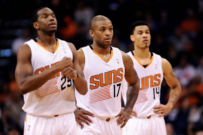Nov 20, 2013; Phoenix, AZ, USA; Phoenix Suns guard Dionte Christmas (25) , forward P.J Tucker (17) and guard Gerald Green (14) stand on the court in the game against the Sacramento Kings at US Airways Center. The Kings defeated the Suns 113-106. Mandatory Credit: Jennifer Stewart-USA TODAY Sports