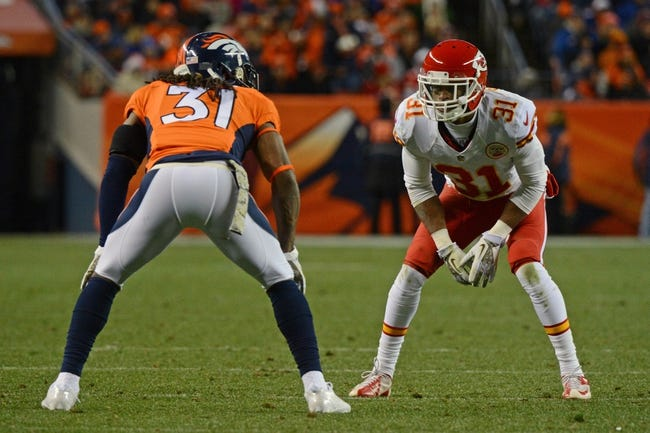 November 17, 2013; Denver, CO, USA; Kansas City Chiefs cornerback Marcus Cooper (31, right) defends against Denver Broncos cornerback Omar Bolden (31, left) during the third quarter at Sports Authority Field at Mile High. The Broncos defeated the Chiefs 27-17. Mandatory Credit: Kyle Terada-USA TODAY Sports