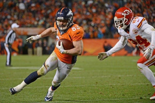 November 17, 2013; Denver, CO, USA; Denver Broncos wide receiver Wes Welker (83) runs with the football against Kansas City Chiefs cornerback Brandon Flowers (24) during the fourth quarter at Sports Authority Field at Mile High. The Broncos defeated the Chiefs 27-17. Mandatory Credit: Kyle Terada-USA TODAY Sports