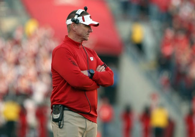 Nov 30, 2013; Madison, WI, USA; Wisconsin Badgers head coach Gary Andersen surveys the field during the game with Penn State  at Camp Randall Stadium. Penn State defeated Wisconsin 31-24. Mandatory Credit: Mary Langenfeld-USA TODAY Sports