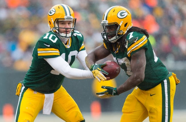 Dec 8, 2013; Green Bay, WI, USA; Green Bay Packers quarterback Matt Flynn (10) hands the football to running back Eddie Lacy (27) during the game against the Atlanta Falcons at Lambeau Field.  Green Bay won 22-21.  Mandatory Credit: Jeff Hanisch-USA TODAY Sports
