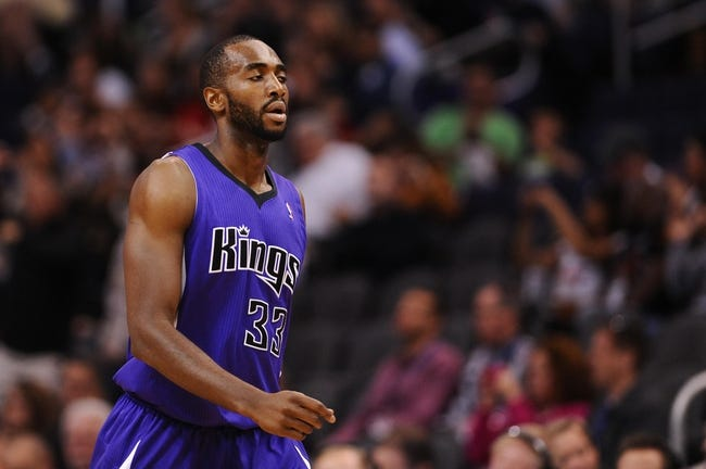 Nov 20, 2013; Phoenix, AZ, USA; Sacramento Kings forward Luc Mbah a Moute (33) walks across the court against the Phoenix Suns in the first half at US Airways Center. The Kings defeated the Suns 113-106. Mandatory Credit: Jennifer Stewart-USA TODAY Sports