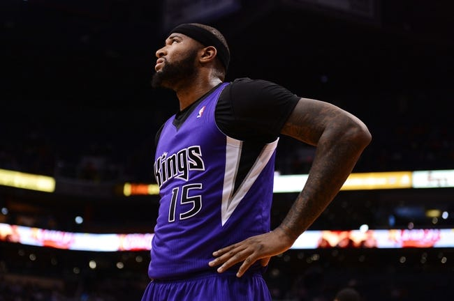 Nov 20, 2013; Phoenix, AZ, USA; Sacramento Kings center DeMarcus Cousins (15) on the court against the Phoenix Suns in the first half at US Airways Center. The Kings defeated the Suns 113-106. Mandatory Credit: Jennifer Stewart-USA TODAY Sports