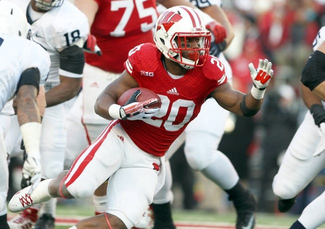 Nov 30, 2013; Madison, WI, USA; Wisconsin Badgers running back James White (20) during the game with Penn State at Camp Randall Stadium. Penn State defeated Wisconsin 31-24. Mandatory Credit: Mary Langenfeld-USA TODAY Sports