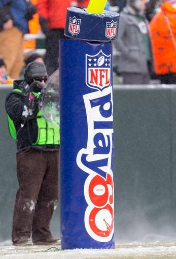Dec 8, 2013; Green Bay, WI, USA; NFL Play 60 padding on the goal post during the game between the Atlanta Falcons and Green Bay Packers at Lambeau Field.  Green Bay won 22-21.  Mandatory Credit: Jeff Hanisch-USA TODAY Sports