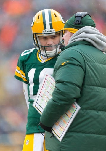 Dec 8, 2013; Green Bay, WI, USA; Green Bay Packers quarterback Matt Flynn (10) talks with head coach Mike McCarthy during the game against the Atlanta Falcons at Lambeau Field.  Green Bay won 22-21.  Mandatory Credit: Jeff Hanisch-USA TODAY Sports