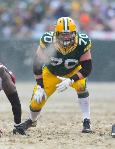 Dec 8, 2013; Green Bay, WI, USA; Green Bay Packers guard T.J. Lang (70) during the game against the Atlanta Falcons at Lambeau Field.  Green Bay won 22-21.  Mandatory Credit: Jeff Hanisch-USA TODAY Sports