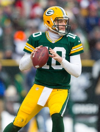 Dec 8, 2013; Green Bay, WI, USA; Green Bay Packers quarterback Matt Flynn (10) during the game against the Atlanta Falcons at Lambeau Field.  Green Bay won 22-21.  Mandatory Credit: Jeff Hanisch-USA TODAY Sports