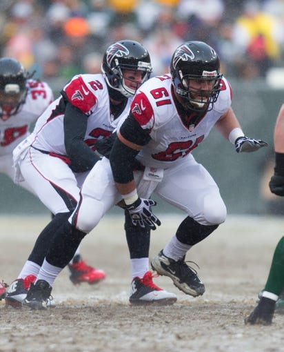 Dec 8, 2013; Green Bay, WI, USA; Atlanta Falcons center Joe Hawley (61) during the game against the Green Bay Packers at Lambeau Field.  Green Bay won 22-21.  Mandatory Credit: Jeff Hanisch-USA TODAY Sports