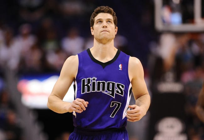 Nov 20, 2013; Phoenix, AZ, USA; Sacramento Kings guard Jimmer Fredette (7) runs on the court against the Phoenix Suns in the first half at US Airways Center. The Kings defeated the Suns 113-106. Mandatory Credit: Jennifer Stewart-USA TODAY Sports