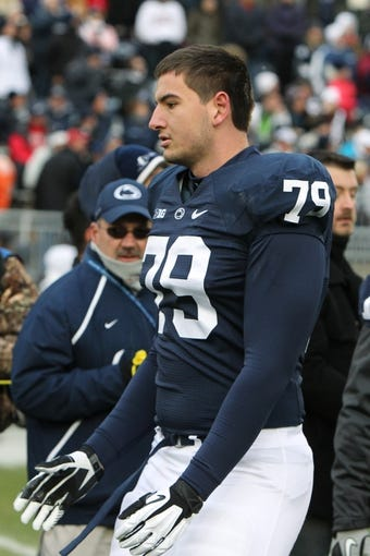 Nov 23, 2013; University Park, PA, USA; Penn State Nittany Lions tackle Kevin Blanchard (79) during senior day recognition prior to the game against the Nebraska Cornhuskers at Beaver Stadium. Nebraska defeated Penn State 23-20 in overtime. Mandatory Credit: Matthew O'Haren-USA TODAY Sports