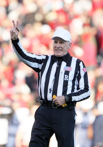 Nov 30, 2013; Madison, WI, USA; NCAA football official Bill LeMonnier concluded his 20-year Big Ten officiating career at  the Wisconsin and Penn State game at Camp Randall Stadium. Penn State defeated Wisconsin 31-24. Mandatory Credit: Mary Langenfeld-USA TODAY Sports